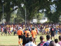 Fans take to the field in Lae